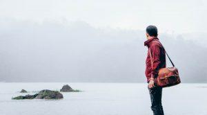 A man standing by a lake (SEL Group Ltd)