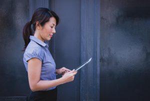 Lady looking at an iPad (SEL Group Ltd)