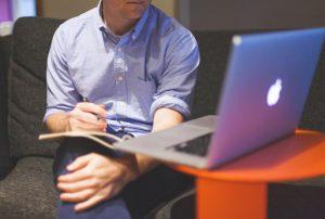 Man working at laptop (SEL Group Ltd)